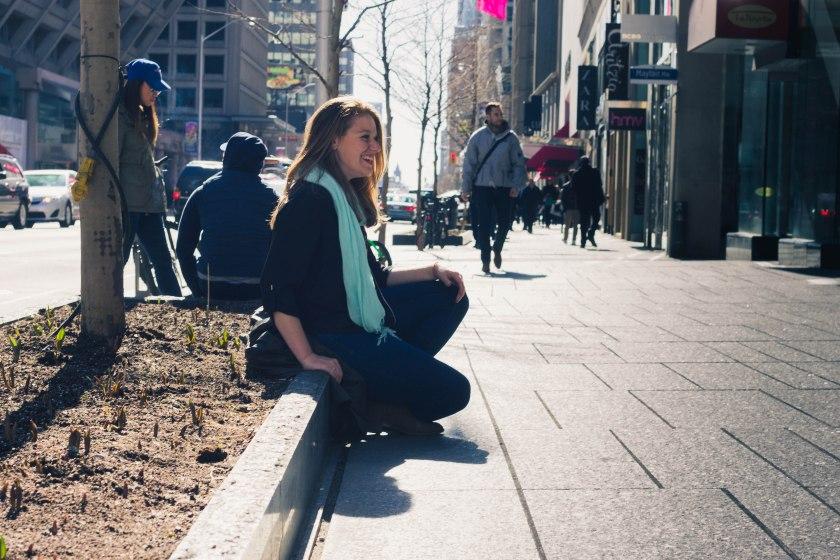 Woman, sitting, sidewalk, toronto, bloor street, yorkville